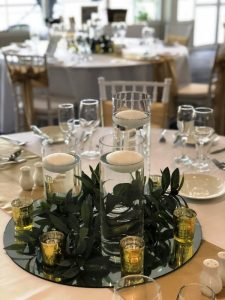 Floating Candles with Artificial Greenery